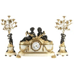 Important Mantle Clock with Matching Candelabras