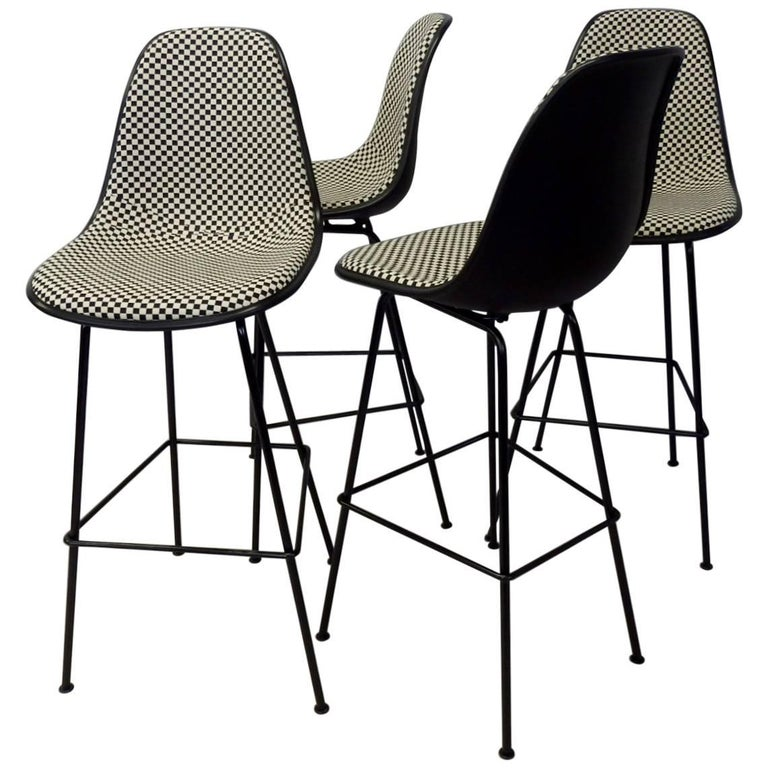 Four Eames Herman Mill Bar Stools with Girard Checkerboard Fabric