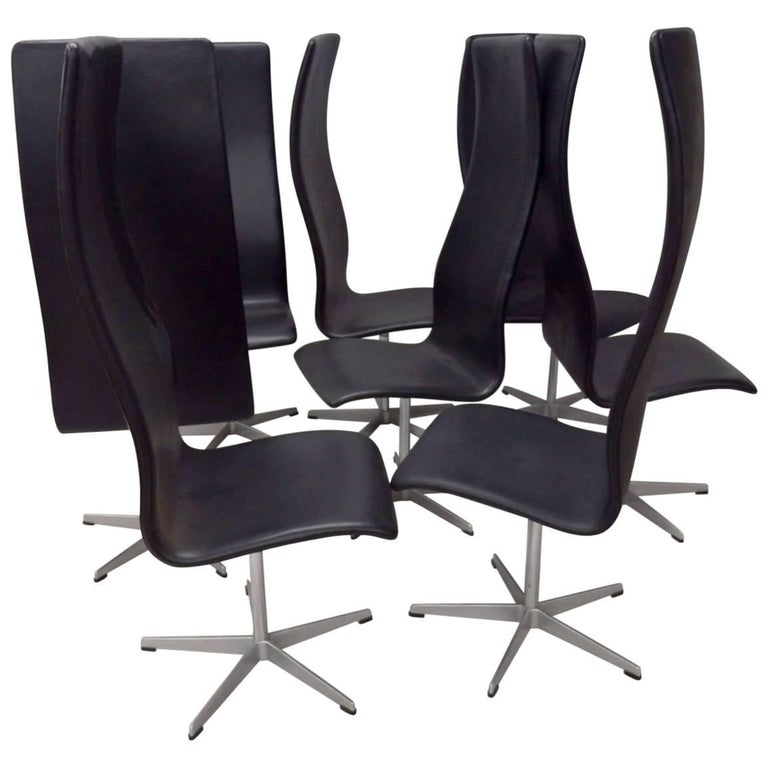 Eight Arne Jacobsen Black Leather Oxford Tall Dining Chairs For Sale