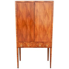 Swedish Art Moderne Storage Cabinet with Inlaid Musical Instruments, circa 1940