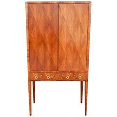 Swedish Art Moderne Storage Cabinet With Inlaid Musical Instruments Circa 1940