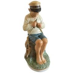 Royal Copenhagen over Glaze Figurine Boy Cutting Stick #905
