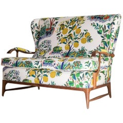 Vintage Wingback Settee Newly Upholstered in Colorful Josef Frank Fabric