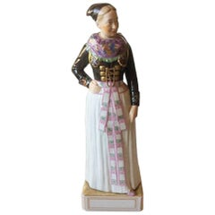 Royal Copenhagen Over-Glaze Figurine 12104 Cook's Costume, Amager Girl