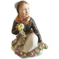 Royal Copenhagen Over-Glaze Figurine of Amager Flower Girl #12412