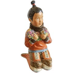 Royal Copenhagen Over-Glaze Figurine Greenland Girl #12415