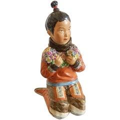 Royal Copenhagen Over-Glaze Figurine Greenland Girl #12415