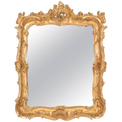 Louis XV Carved and Gilded Mirror with Carved Shell and Scrolls
