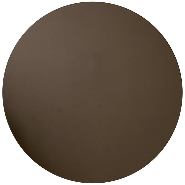 Delightful crafted bronze round mirror frameless.  Ideal above a console table in the hallway, above a beautiful fireplace, in the bedroom or in the bathroom. Measures: Dia. 100cm / 39.4