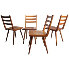 Set of Four Elegant Dining Chairs from the 1950s
