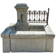 Wall Fountain of Provence in Patinated Natural Stone and Antique Wrought Iron