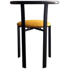 Minimalist Black Metal Chair with Yellow Fabric Seat
