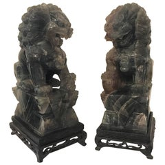 Pair of Chinese Carved Green Quartz Foo Dogs