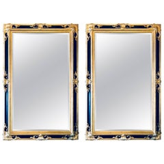 Pair of Italian Gilt and Ebony Beveled Monumental Console or Wall Mirrors