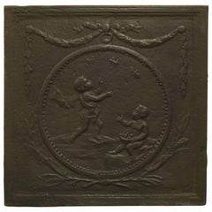 Antique Fireback with Two Cupids in a Circle