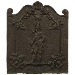 "Antique Decorative Fireback Displaying a Man with a ""Top Hat"""