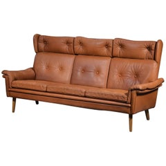 Sven Skipper 1960s Danish Three Person Coupe Wingback Sofa in Cognac Leather
