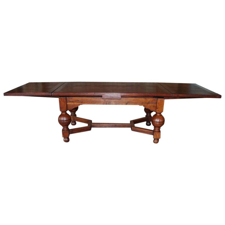 Dutch Renaissance Style Oakwood Draw Leaf Extension Dining Table For Sale