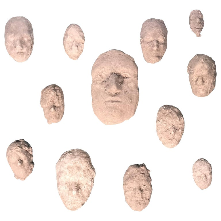 Neal Beckerman Set of 12 Abstract Plaster Relief Sculptures, Heads