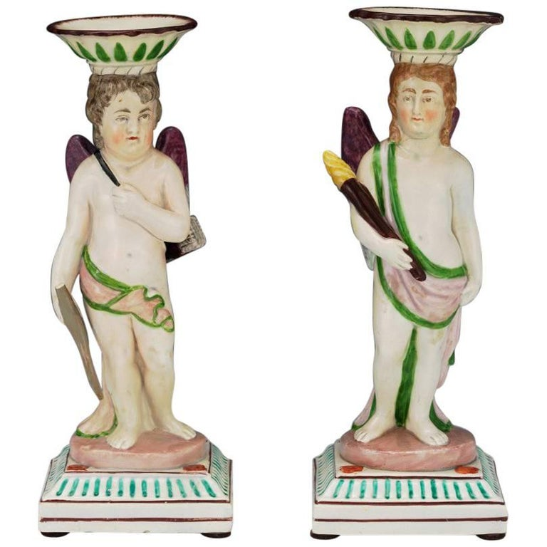 Pair of English Pearl Ware Figural Candlesticks, Attributed to Neale & Co.