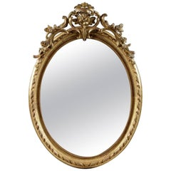 Fine 19th Century French Oval Mirror of Napoleon III Period in Carved Giltwood