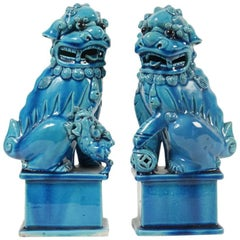 Paire of Turquoise Porcelain and Enamel Pho Dogs, circa 1900