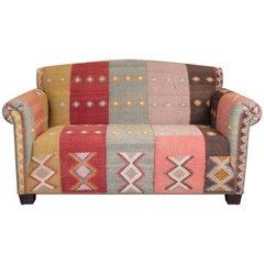Loveseat Upholstered in a Vintage Turkish Rug