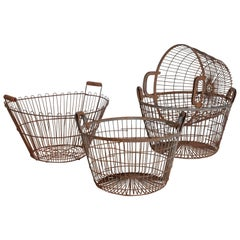 Associated Group of Four French Wire Baskets, 20th Century