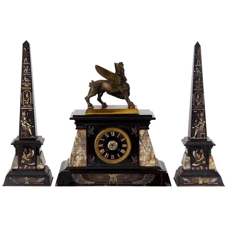 Egyptian Revival Three-Piece Clock Garniture Flanked, Obelisk France, circa 1880 For Sale