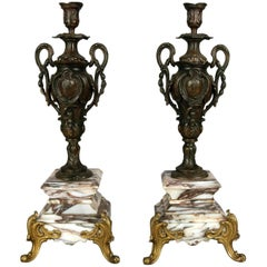 Pair of Classical Parcel-Gilt and Bronzed Urn Form Candlesticks on Marble Base
