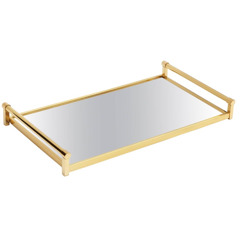 A rare example of this stunning and well documented tray by Jacques Adnet for Compagnie Des Arts Francais , in virtually unused condition.  Exuding style in its simplicity, the tray is finished in polished brass and mirrored glass base that