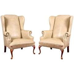 Pair of Tan Faux Leather Wing Chairs