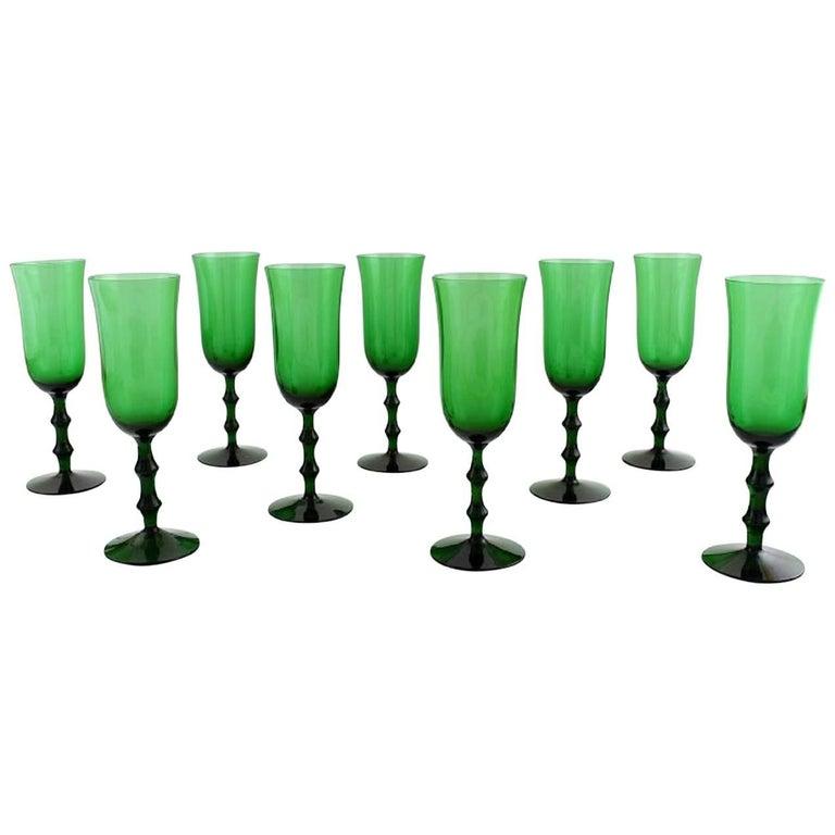 Simon Gate Orrefors, a Set of Nine Green Champagne Art Glasses