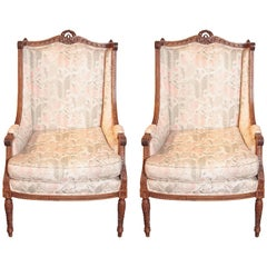 Pair of Late French Louis XVI Fruit Wood Carved Bergeres