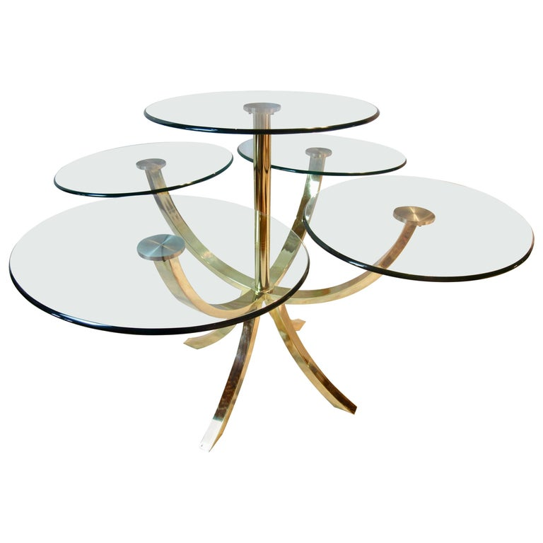 A Design Institute of America brass and glass dining table for four  1970s. The D. I. A.