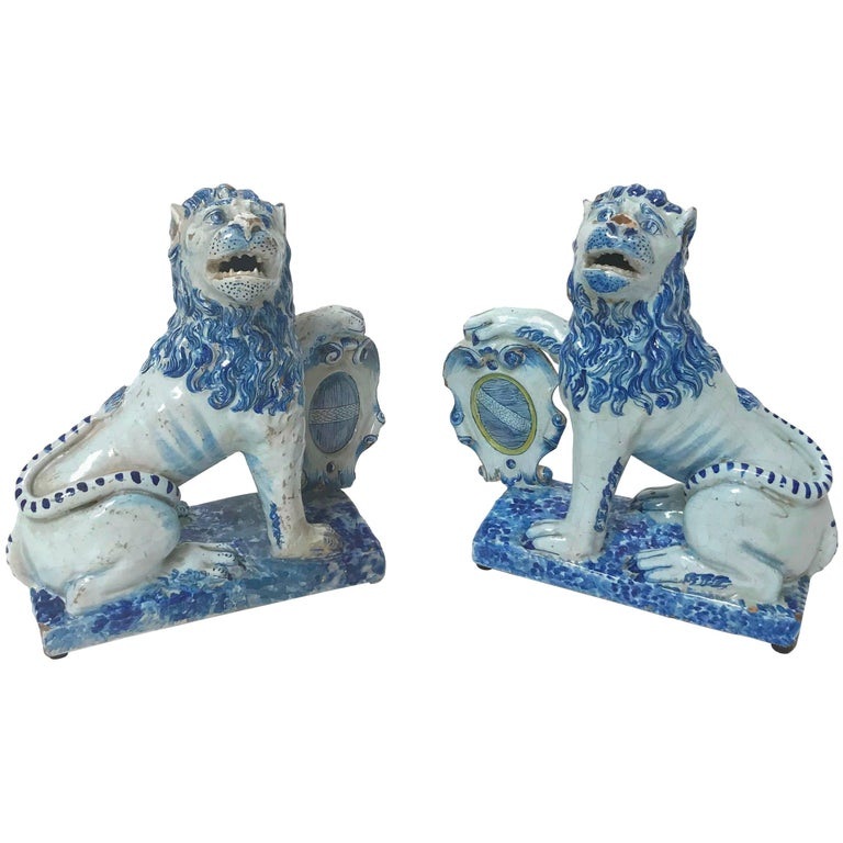 Pair of 18th Century French Faience Lions For Sale