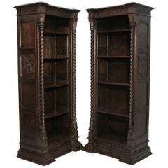 Pair of Spanish Revival Oak Bookcases, American, circa 1920