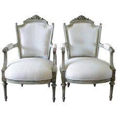Pair of 19th Century Painted and Upholstered Louis XVI Style Open Armchairs