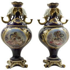 Pair of 19th Century Cobalt Blue Sèvres Style Vases with Elephant Handles