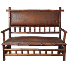 Perret Vibert Bamboo Settee Retaining the Original Decorated Leather Upholstery