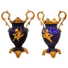 Pair of 19th Century Cobalt Blue Porcelain Urns with Fine Gilded Bronze Elements