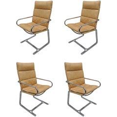 Four Tubular Chrome Cantilever Style Armchairs by Cosco Inc after Milo Baughman