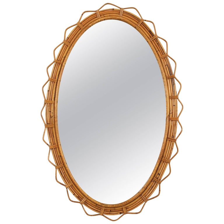 Large 1950s French Riviera Bamboo and Rattan Jagged Edge Oval Sunburst Mirror