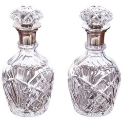 Pair of Antique Silver Topped Cut Glass Decanters