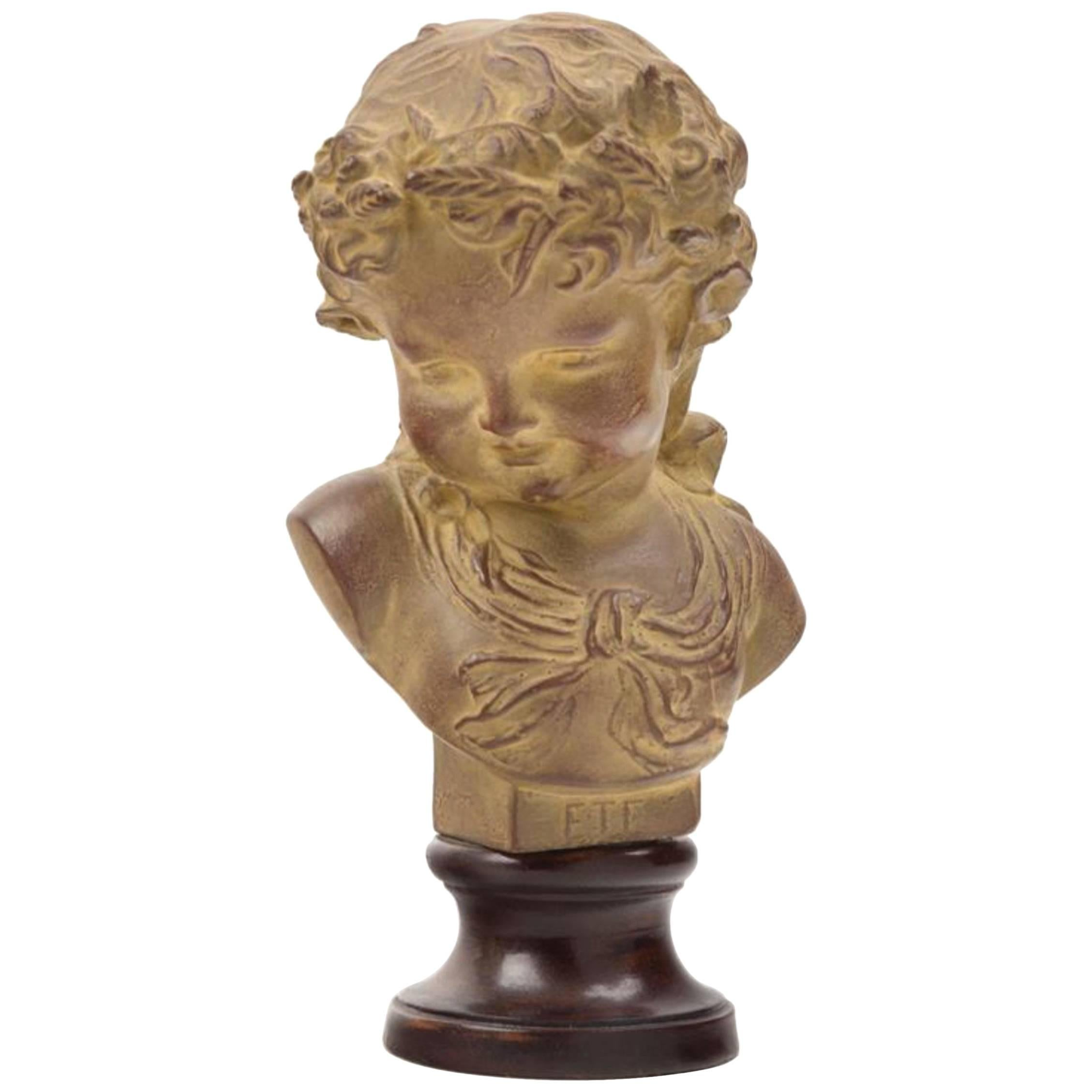 Charming French Terracotta Bust on Ebonized Wood Base Depicting Young Child.