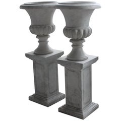 Pair of Classical Style Carved Marble Urns on Plinth Pedestals