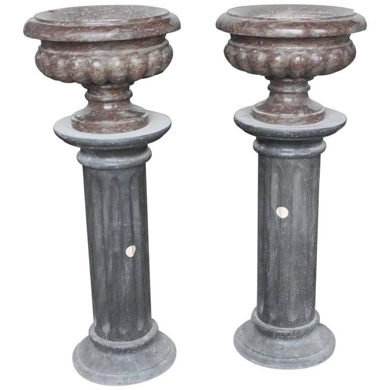 Pair of Rouge Purple Marble Urns on Black Marble Pedestals