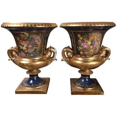 Pair of French Style Painted and Gilded Porcelain Classical Urns