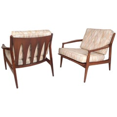 Pair of Mid-Century Modern Walnut Lounge Chairs in the Manner of Ib Kofod Larson