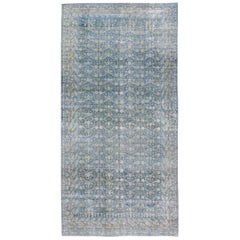 Large Antique Khotan Rug with Blue All-Over Design of Blossoms and Flowers